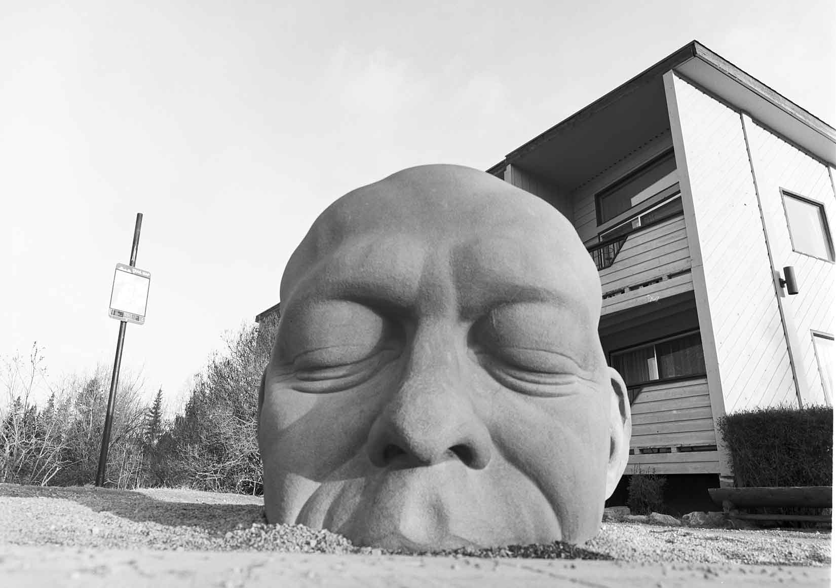 The Big Head statue downtown Canmore. Photo by Damian Lamartine