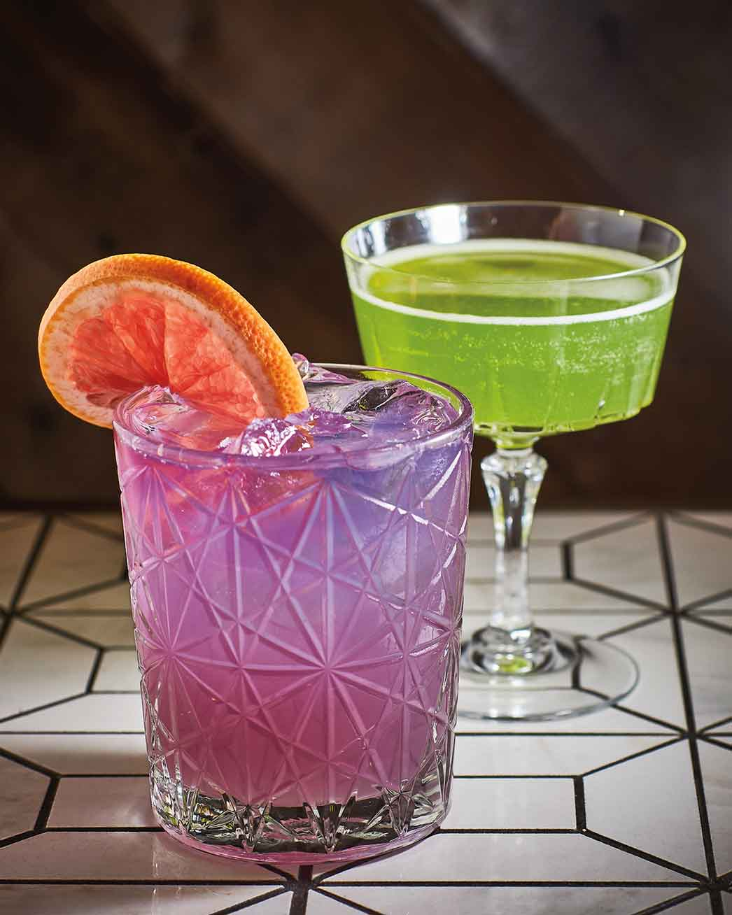 Mountain cocktails from Where the Buffalo Roam include the High Violet purple tumbler and Misty Mountain Hop. Photo by Damian Lamartine