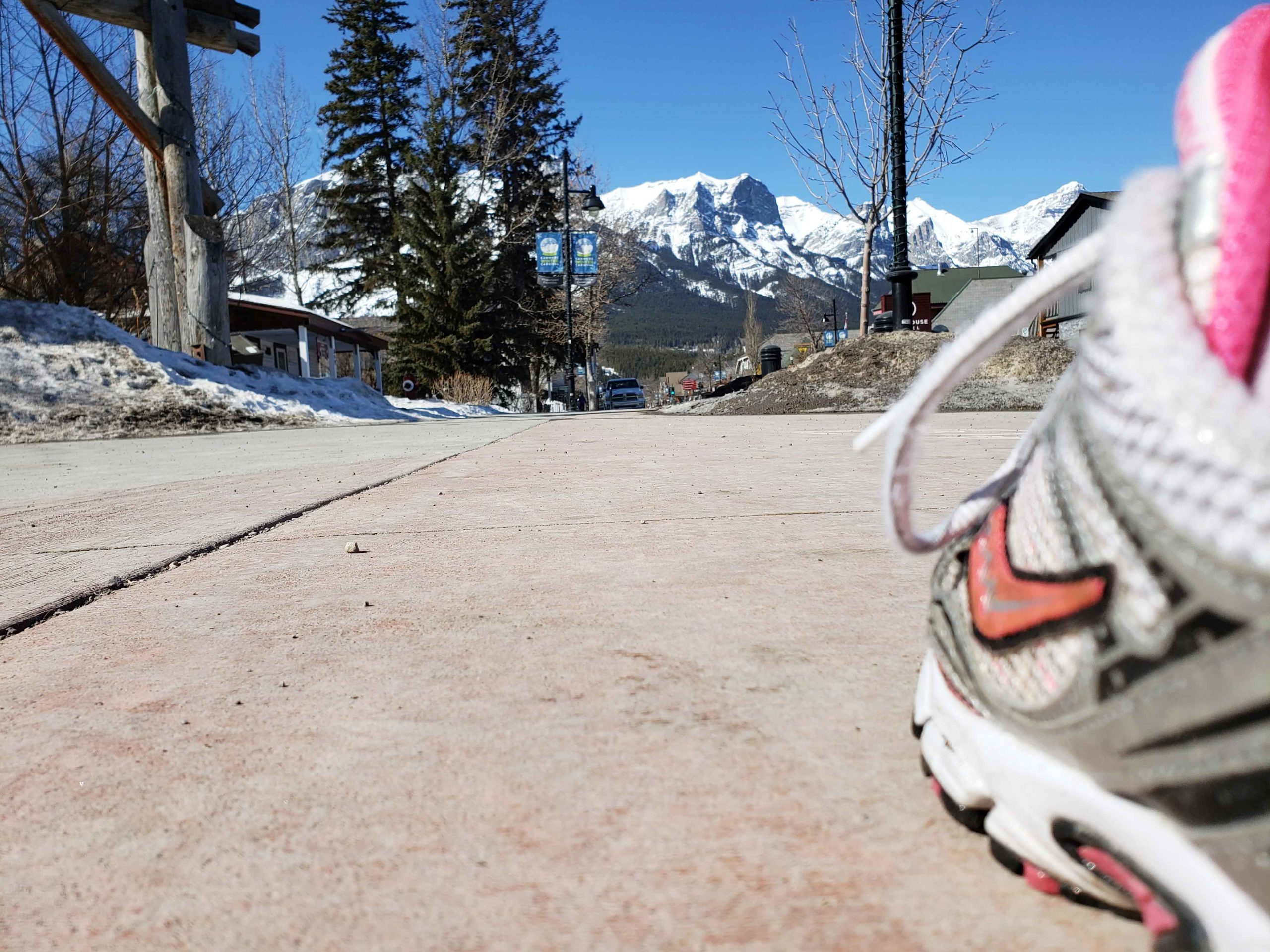 Running shoe on Main Street, Canmore with no one around. Taken for the Strides Virtual Challenge