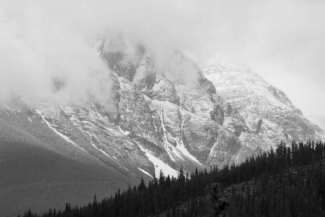 Mountain shrouded with clouds by Jack Hawkins
