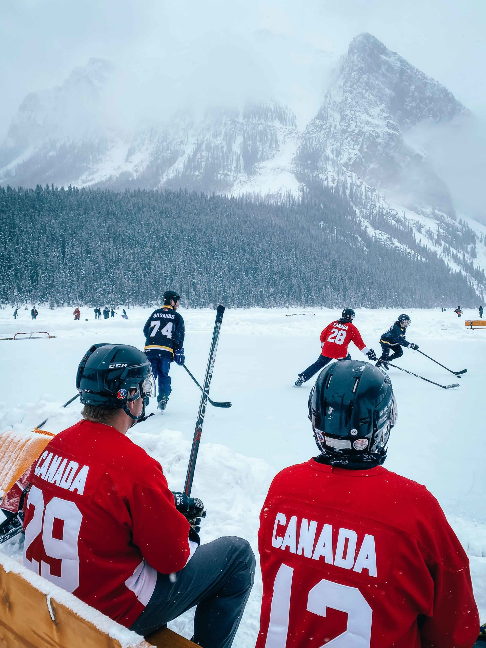 Using a foreground, like the hockey players in this photo, is one of the great photography tips for your phone by Sanjay Chauhan