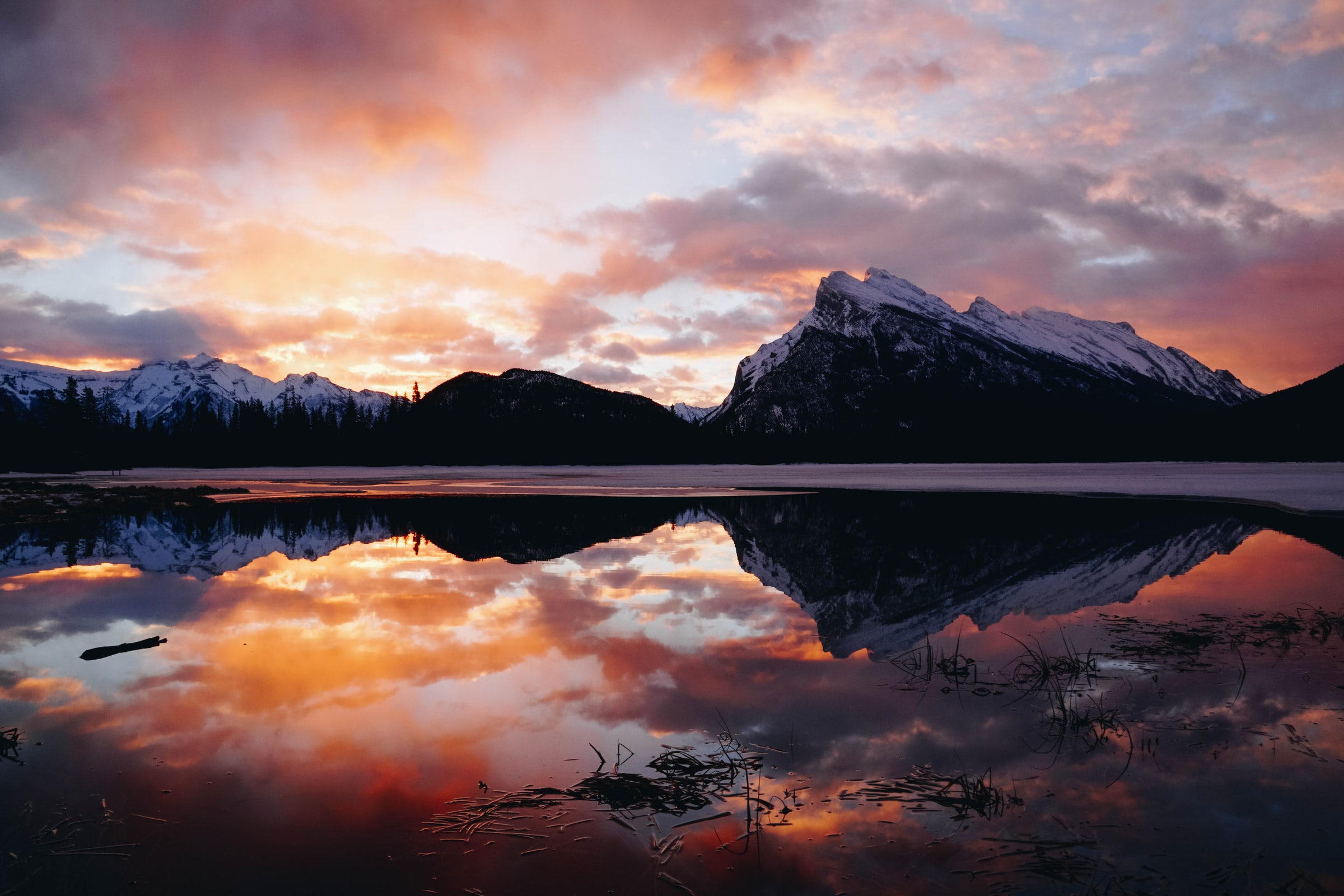 The iconic Rundle Mountain reflecting in Vermillion Lakes during a colourful sunset is an iconic Canadian Rockies photograph