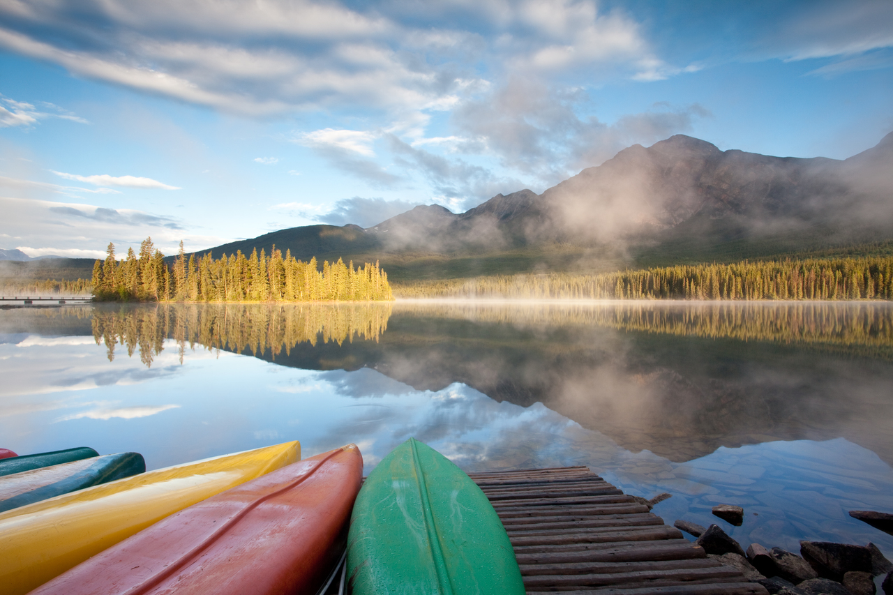 Colourful canoes line the dock at Pyramid Lake in Jasper, a precursor to the perfect day on the water