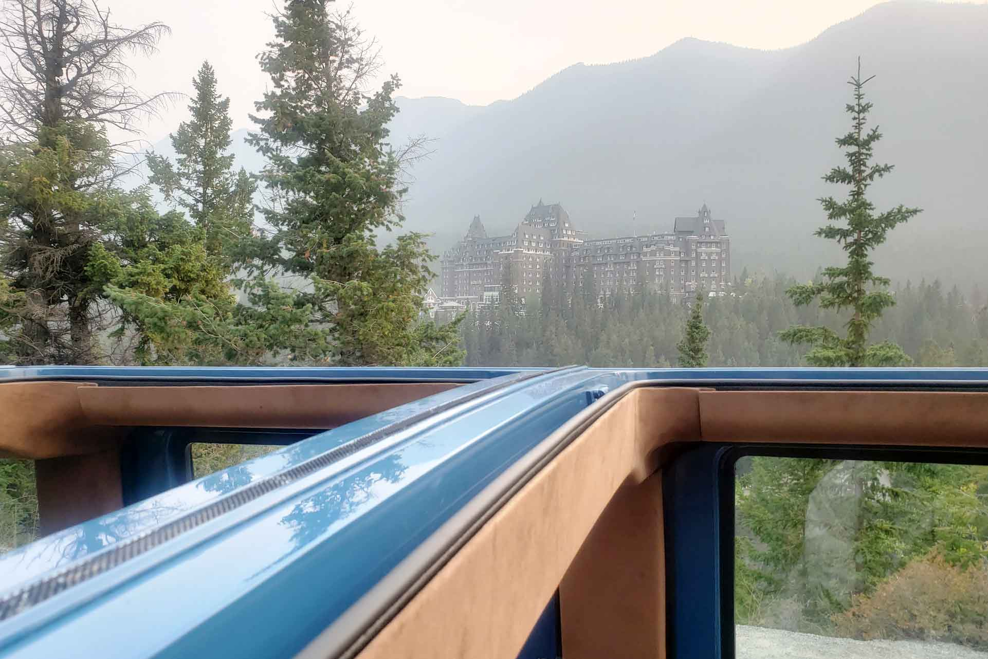 Looking at the Fairmont Banff Springs through the roof of Pursuit's Open Top Touring bus